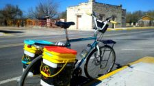 Bike with rear rack and two kitty litter bucket panniers