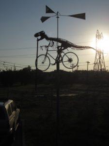 T-Rex sculpture riding bike